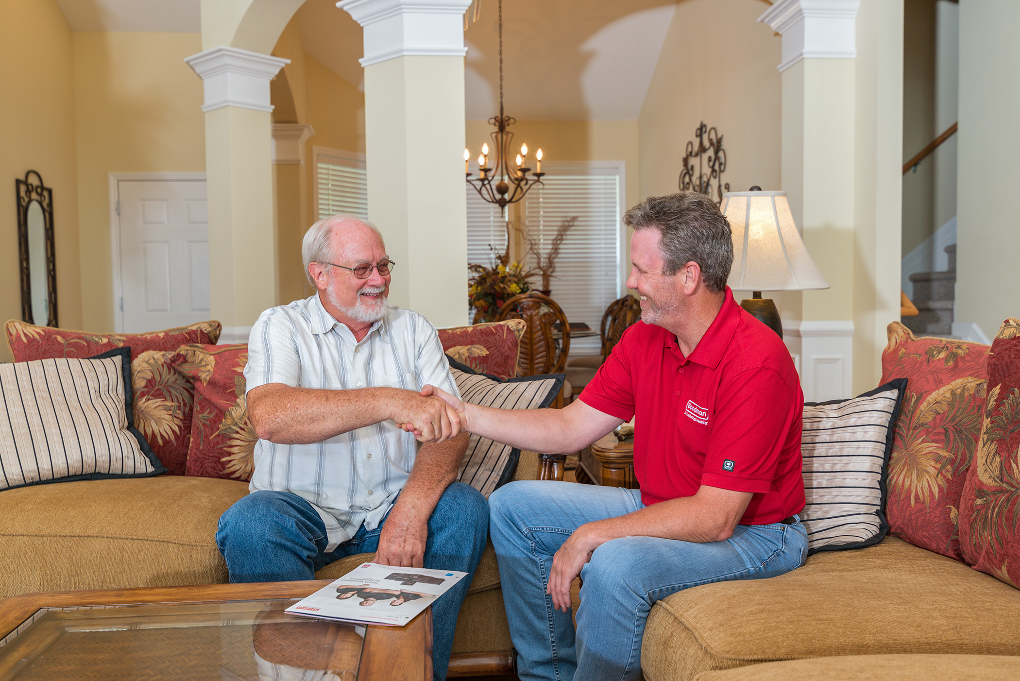 Goodman HVAC dealer discussing options with homeowner